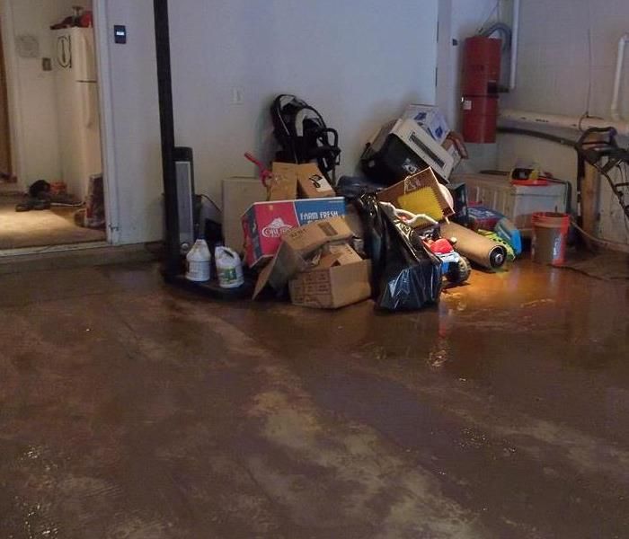 Standing water and mud have flooded the basement.