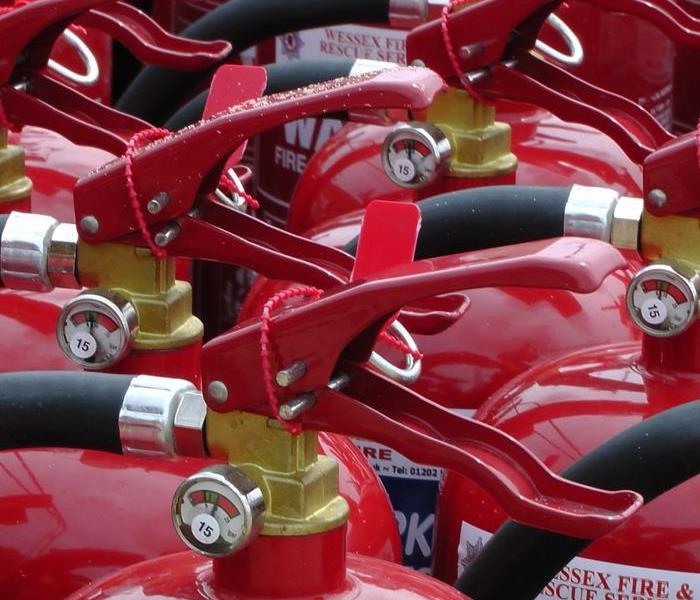 The tops of fire extinguishers are shown.