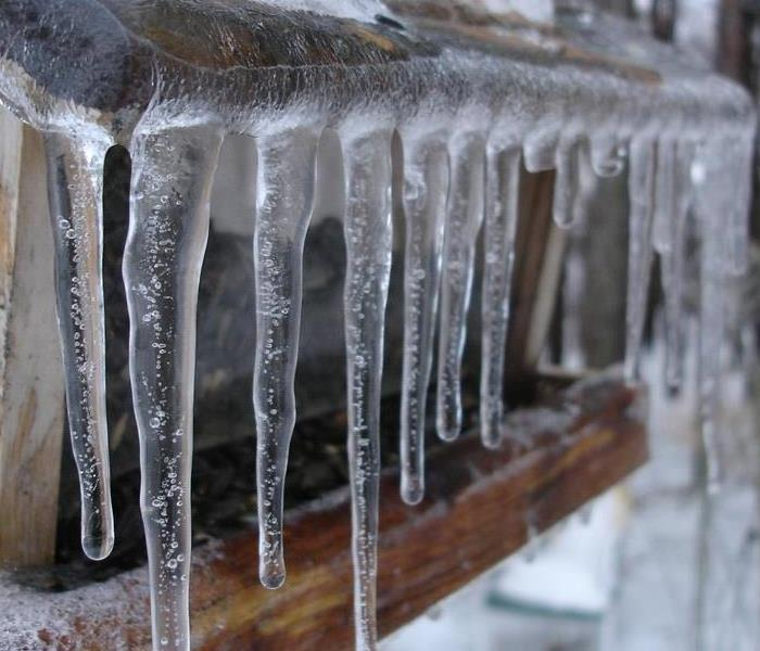 icycles hanging from a frozen gutter